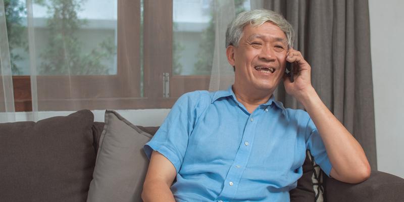 Elderly-man-having-a-happy-phone-call