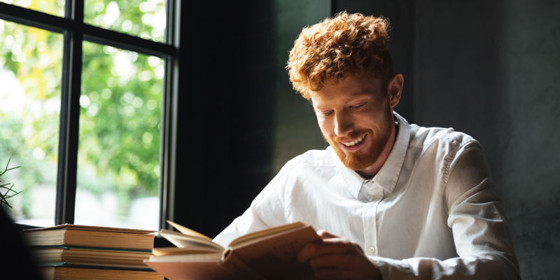 Young-man-reading-a-book