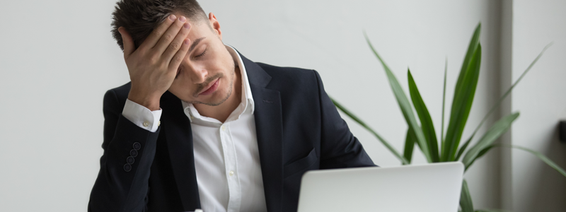 Man-holding-his-head-with-stress-affecting-his-mental-health